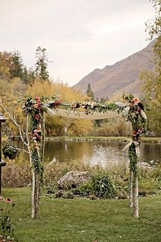 How pretty would this rustic arch be for an outside wedding !