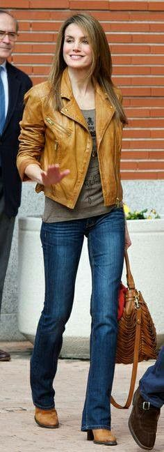 Queen Letizia of Spain in tan leather jacket and blue denim jeans