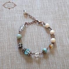 Vintage Style Bracelet - Beaded bracelet - Versatile bracelet -Christmas Gift A beautiful Vintage Style bracelet with Gemstones and Vintage pearls. Features Aquamarine , Amazonite , Rhinestones, Vintage pearls , Czech glass . The bracelet finishes with an antique copper lobster