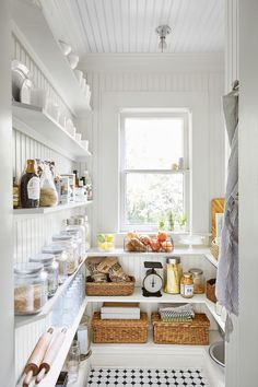 ~Like the beadboard on ceiling.and white of course :) ~Beadboard paneling and eye-pleasing open shelving take this utilitarian space from practical to pretty. Clear canisters and wicker bins keep (almost) everything in plain sight. Pantry Inspiration, Monday Inspiration, Shelf Inspiration, Small House Decorating, Cottage Decorating, Decorating Ideas, Decor Ideas, Room Ideas, Pantry Organization