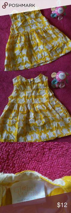 Yellow and White Spring Baby Girl Dress 18 mo Beautiful yellow and white toddler dress. Made by Global Mamas. Has a lighter yellow tye dye bleed design throughout. The dress is made by hand in Ghana. Pre-owned. Please see all photos. Size 18 months. Handmade.  Perfect for Spring or Summer.  Thanks so much for looking! =) Global Mamas Dresses Casual