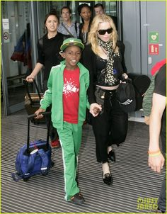 Madonna arrives on a flight in London with her kids David and Mercy on July 19, 2013
