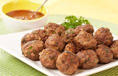 Mexican-Spiced Cocktail Meatballs: These cocktail meatballs are flavored with Mexican-inspired ingredients like cinnamon, cumin, lime and cilantro and are served with a mole-style dipping sauce.