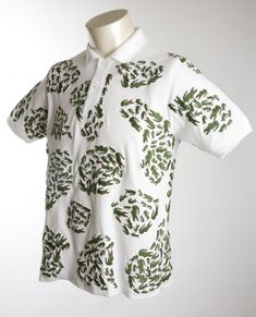 Campanas + Lacoste polo shirt. Brazilian desginers Fernando and Humberto Campana's collaboration with Lacoste. Alligator appliqués were made by women from Rocinha, a favela in Rio. 2009.