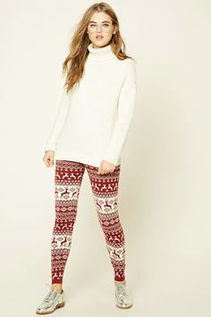 03a41fa12fefe0 Style Deals - A pair of sweater knit leggings featuring a reindeer and  snowflake fair isle