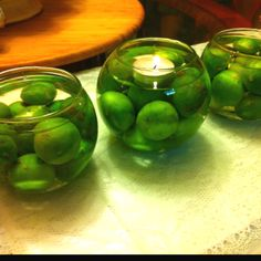 Engagement Party Centerpieces...  easy and cheap!** glass bowls from the dollar store  + cheap kiwi limes from the mexican grocery store + free water from my sink  :P