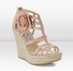 Jimmy Choo wedges, oh yes, too bad the link this goes to doesn't actually have any!