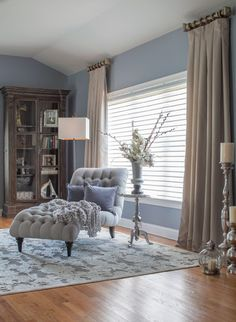 Custom silk drapes- hang the rod right to the ceiling for a dramatic effect.
