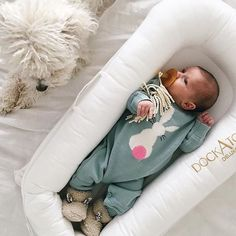 A girl, a pup and her DockATot. Now that's what we call a watchdog! Baby lounger by DockATot, the must have baby gear for moms looking for a safe and snug spot to place their little ones. DockATot is ideal for nap time, co-sleeping and snuggle time. Made from luxurious and breathable fabrics that mimic the womb. Dockatot.com for more info and to buy.