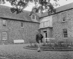 Scottish racing driver Jim Clark (1936 - 1968) heads out with his shotgun at the family home, Edington Mains Farm in Berwickshire, UK, August 1963.