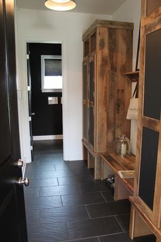 rustic mudroom, chalkboard front locker doors, slate floor