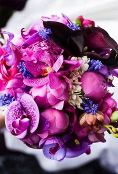 Pump up the flower power with an alluring arrangement of orchids, roses, ranunculus and peonies in shades of pink and purple. Rose Fushia, Purple Orchids, Purple Flowers, Ranunculus, Peonies, Pink Purple Wedding, Orchid Color, Artificial Orchids, Types Of Flowers