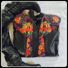 Gorgeous detailed leather jacket OMG  what should I say about this pretty leather jacket with 100% rayon lining and trims with sequins dealing . Few sequins missing here and there but it doesn't  affect the beauty of this gorgeous piece . Wear it with your favorite jeans or a dress this would definitely get u attention . Dry clean only . Ask me for additional  pics or size if u want .  Bought it over $300, make a reasonable offer and I will accept it .. Tags says small but it would be…