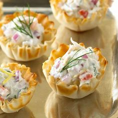 Crab Dip recipe: Standard crab dip gets perked up with fresh dill, lemon juice, and hot sauce.  Try it on crackers or in phyllo cups.