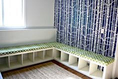 Storage/Seating Bench Get storage and an extra place to sit when you build this DIY corner bench with cubbies. It's a great project that is perfect for any playroom, bedroom, or even the living room. Wherever you have a corner wall space, you can fit this in. It's got cubbies underneath so you have loads of storage space and you just top it off with a cushion (that you can also DIY) and it makes a beautiful corner bench. The cubbies will store books, toys, or anything else you want and you…