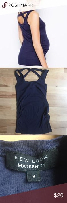 ASOS New Look Maternity Tank Re-Poshing. Got a little over zealous buying maternity clothes and never actually wore this one. Original posher worn a few times and the top is still in great condition. Navy blue with crisscross design at back. Can still wear regular bra with. UK 8 = US 4. Bundle with other maternity clothes for additional savings! ASOS Maternity Tops Tank Tops