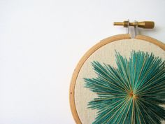 Hey, I found this really awesome Etsy listing at https://www.etsy.com/listing/100590795/teal-blue-and-gold-starburst-embroidery