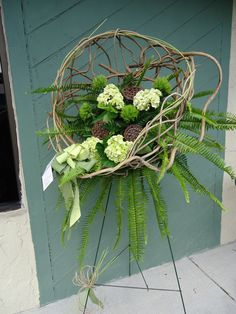 Sympathy Floral Spray w/ Natural woven basket, green trick, sword fern and green hydrangea  Angel Blooms Florist  Ft Myers, FL