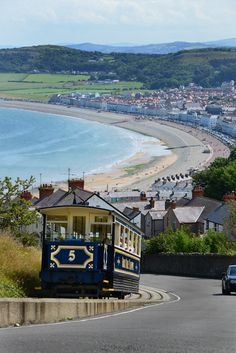 A tram descends from the Great Orme down to Llandudno, Conwy, Wales by pentlandpirate