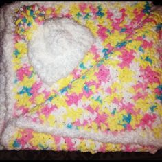I made this!!! Candy coloured baby blanket made with Bernat Baby Blanket yarn in Pitter Patter with matching beanie!
