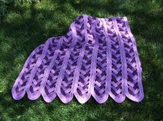 Mile-A-Minute Braided Afghan done in purple tones.