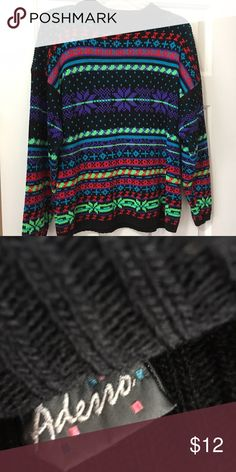 Sweater Nice, colorful sweater. Lightly worn. No picks or fuzzies. Sweaters Cardigans