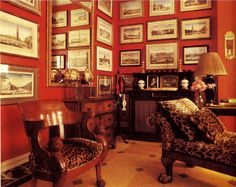 .Gallery Walls with old architecture prints and a red wall