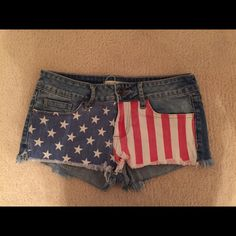 American Flag Shorts American Flag Shorts. Jean shorts with a little fringe on the bottom. Super cute for summer outfits. Size 0 Bullhead Shorts Jean Shorts