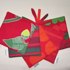 Marimekko Christmas pot holders.   ♥ Great hostess gift ♥ https://www.etsy.com/listing/110986147/christmas-marimekko-pot-holders-set-of-2?ref=shop_home_active
