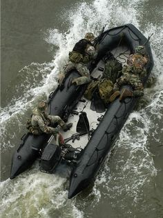 Navy SEALs in position for insertion/extraction via Zodiac.