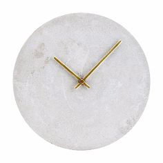 A Scandi inspired concrete clock by House Doctor. This is a wall hanging clock with one key hole hook to hang from the wall. Takes one AA battery.