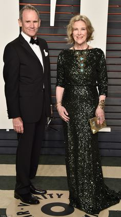 More sparkles: Actress Catherine O'Hara wore an elegant emerald gown as she arrived with h...
