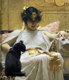 It makes sense to me that Cleopatra had a cat--probably had a cattery of them since they at the time were considered sacred. In fact, two feline goddesses were worshipped during Cleopatras time--Mafdet, goddess of protection of dangerous animals and Bastet, the cat goddess of beauty, women and fertility. Pictured in this painting, Cleopatra by John William Waterhouse is Beketaten, the royal cat to Cleopatra. Okay, so I had a little digital art fun and added a cat to the painting. Note the…