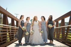 Half Moon Bay Wedding. Bridesmaid in mixed grey dresses.  www.heartsandhorseshoes.com #weddingphotography #wedding