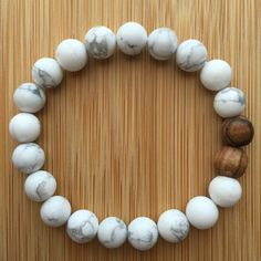 Howlite and Lava Rock Mala! Howlite is a calming stone, perfect for facilitating personal and spiritual awareness and attunement. Howlite can be used to attune to healing energy. Diy Jewelry, Jewelry Box, Jewelery, Jewelry Accessories, Handmade Jewelry, Jewelry Making, Beaded Jewelry, Bracelets For Men, Beaded Bracelets