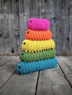 ○ Rainbow coloured knitted caterpillars