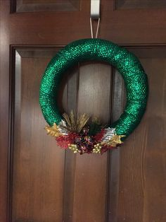 Styrofoam wreath wrapped with wide ribbon