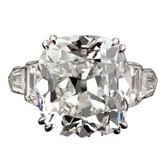 Antique Cushion Cut Diamond Ring Accompanied by two emerald cut and two shield cut diamonds, weighing 1.60 total carats, set snugly in the band.  A+++ setting ★★★★★