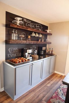 Long cabinet, open shelves, chalkboard paint on the wall.