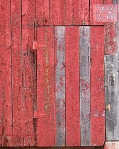"""Striped Barn Door"" by Anne M. Freeman.  This old barn door has the prettiest combination of rosy pink and silvered gray.  I'm unsure what the original color paint must have been, because I've never seen one weather to this lovely color!  To purchase this print, contact me at www.AnneFreemanImages.com"
