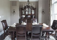 Dining room from The Official Home Showcase of the Builders Association of Greater Indianapolis #dark #wood #table #chandelier #armoire #elegant #nice #traditional (Photos by Tony Valainis)