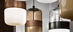 FUTURA Collection of pendant lamps in blown glass available in three exclusive colors combined with different finishes of the metal ring. The glass is blown in one piece but the particular handcraft process makes the colour transparent in the upper part and diffuser in the bottom part.