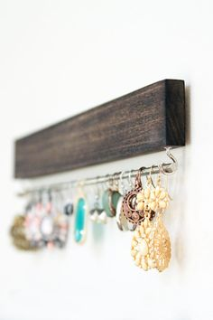 This listing is for a stained and waxed wood earring display with two hooks (either gold/brass or nickel) and a solid bar (either brass or silver) to