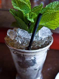 Mint Juleps!  Love 'em.  And this is an appropriate frosty Southern Mint Julep glass.