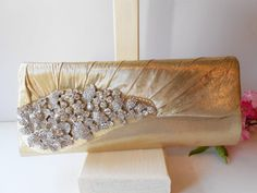 Hey, I found this really awesome Etsy listing at https://www.etsy.com/listing/206177086/gold-evening-bag-with-rhinestone-trim