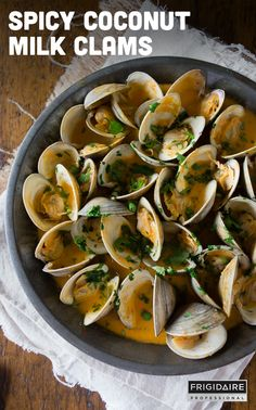 These spicy coconut milk clams are packed full of Thai flavor and cook in less than 20 minutes. It's full of spicy red chiles and sweet coconut milk to create the perfect sweet and spicy seafood Clam Recipes, Fish Recipes, Seafood Recipes, Asian Recipes, Dinner Recipes, Cooking Recipes, Healthy Recipes, Cooking Kale, Cooking Pumpkin