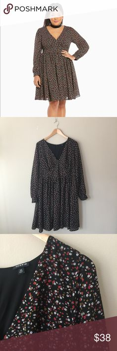 Torrid Floral Dress Size 14 Torrid Floral Dress. Super cute! A size too big on me, brand new. torrid Dresses Long Sleeve