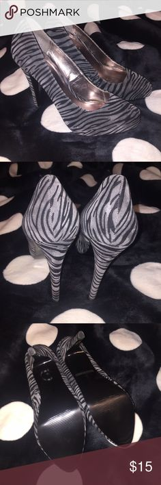 Zebra print faux suede heels Size 7.5 black and gray zebra print faux suede heels. Never worn. Shoes Heels