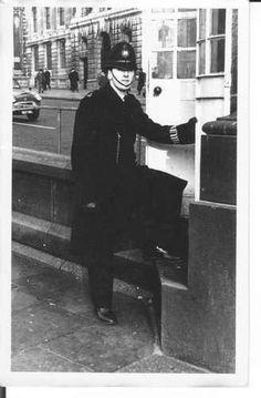 Constable 597 'A' Reg Leonard, Trafalgar Square, (South East Corner) London UK 1962 Police Constable 597 'A' Reg Leonard, Trafalgar Square, (South East Corner) London UK 1962 Police Box, Police Officer, London Metropolitan, London Police, Black Helmet, Police Uniforms, Trafalgar Square, Old London, Great British
