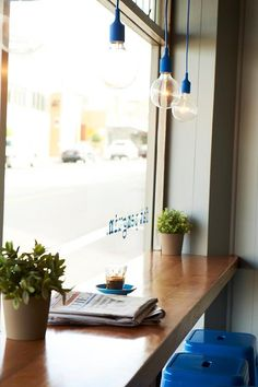 window seat, color stools, lighting fixtures in window